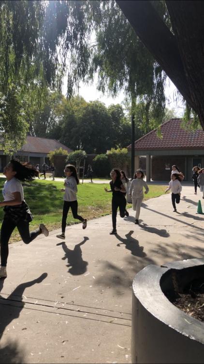 Girls racing around YB's campus.