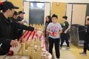 Students receiving their lunches from the Panda luncheon