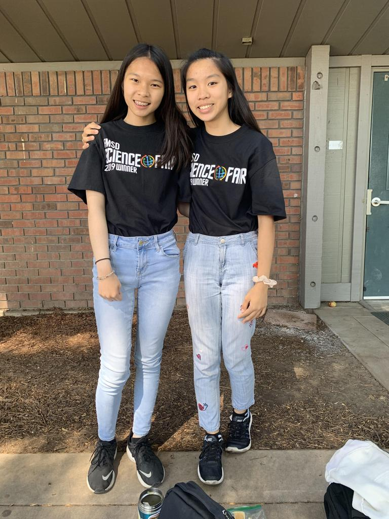 Two students wearing Science Fair t-shirts and jeans for twin day.
