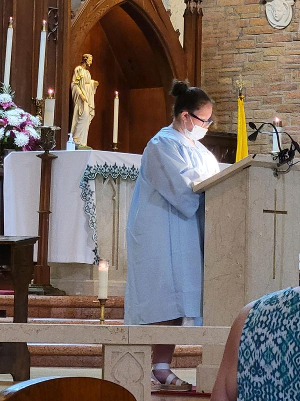 Phebe reads during Mass.