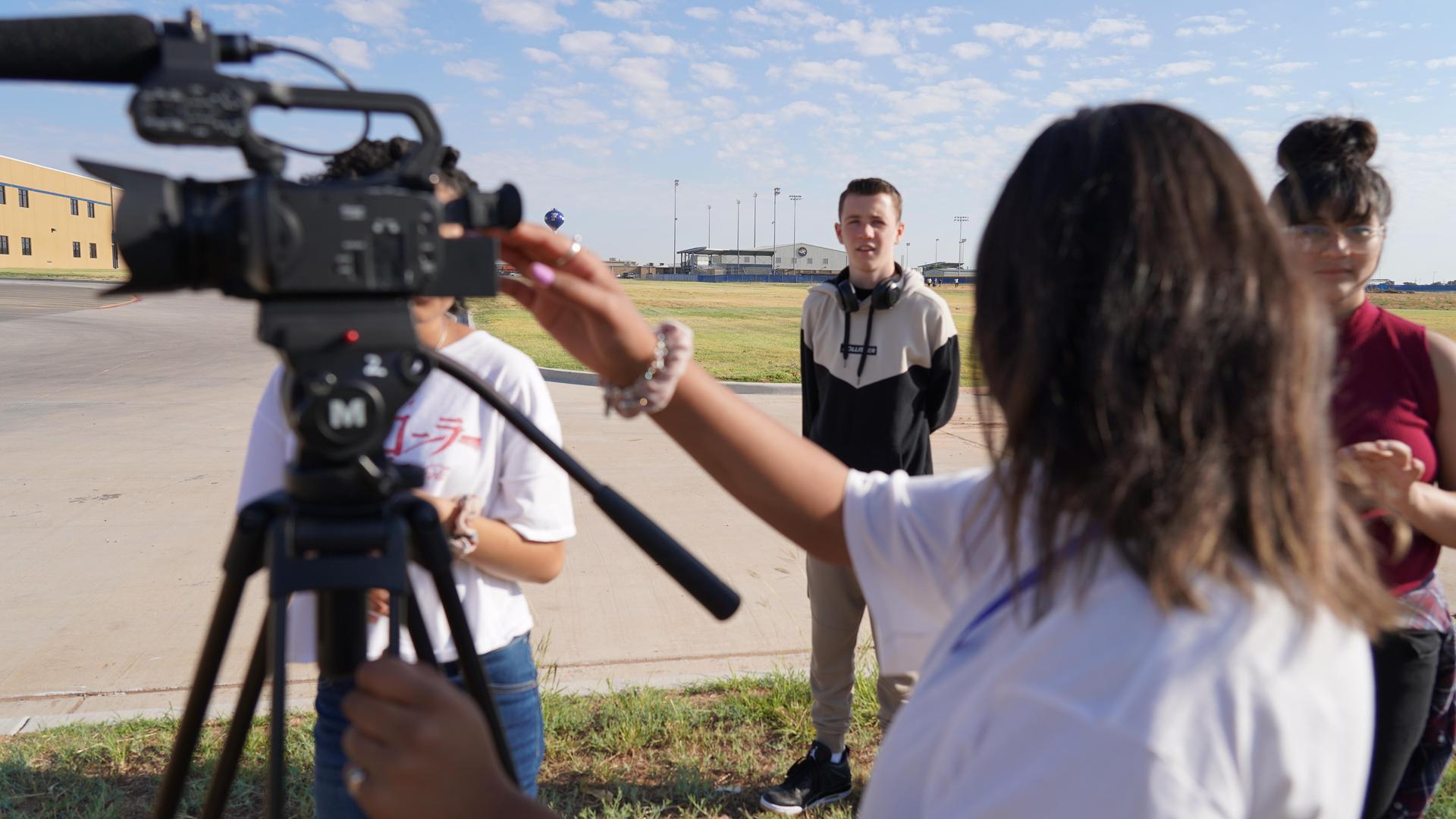 media students behind camera