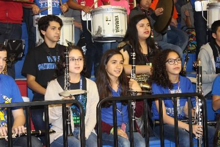 MJHS band students waiting for their cue to play during a pep rally.