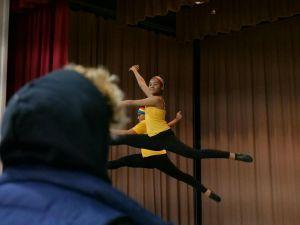Students performing, mid air jump
