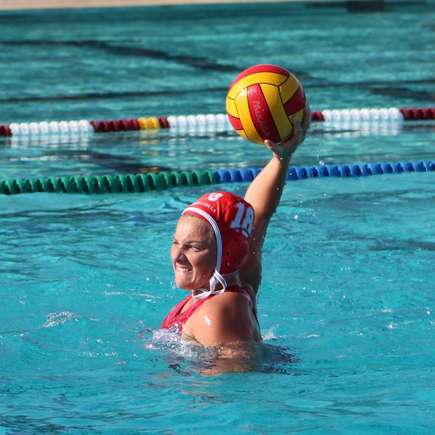 Girls Water polo player with the ball