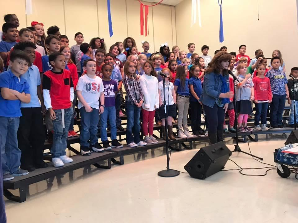 Students on stage during a Veteran's Day Program