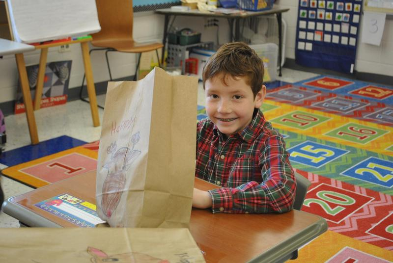 Student with gift bag