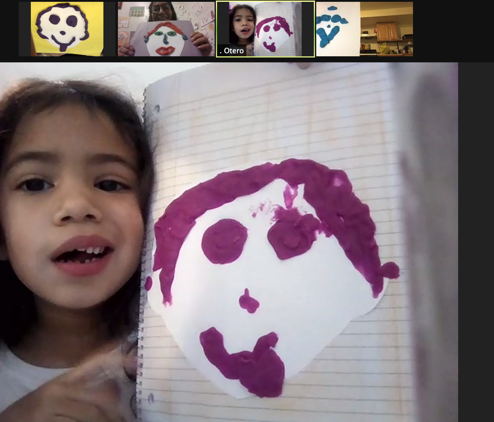 student holding her picture