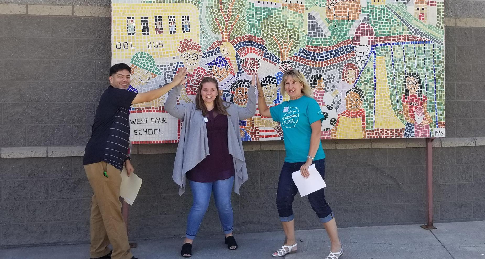 New teachers pointing mural at West Park.