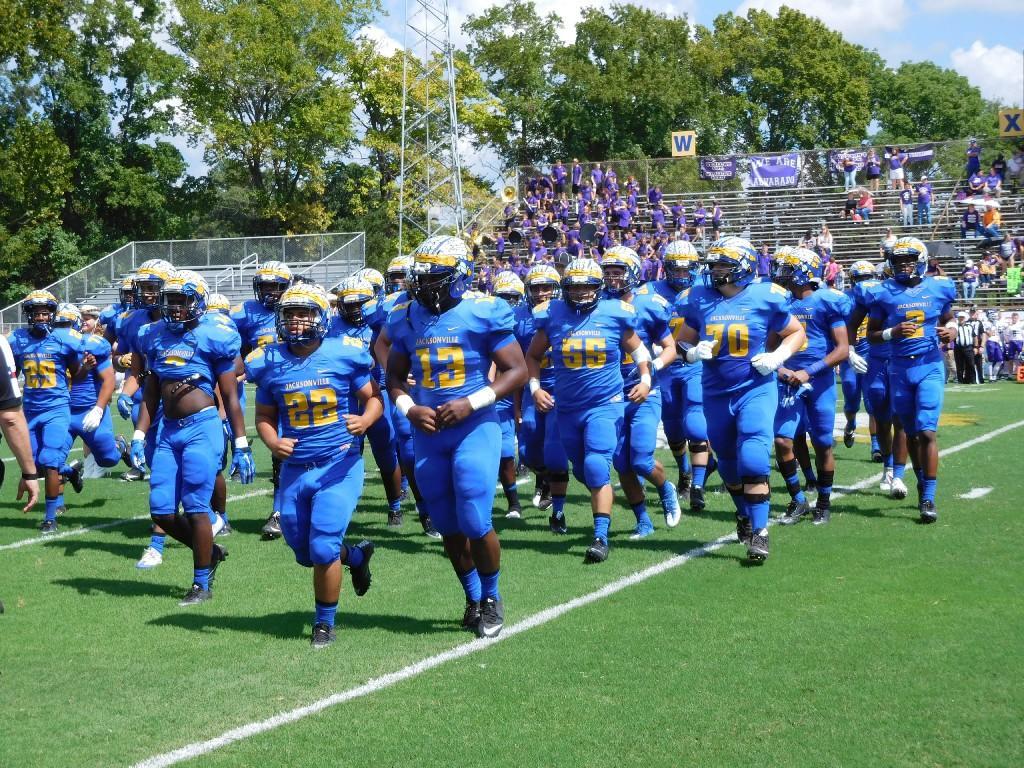 team running on field