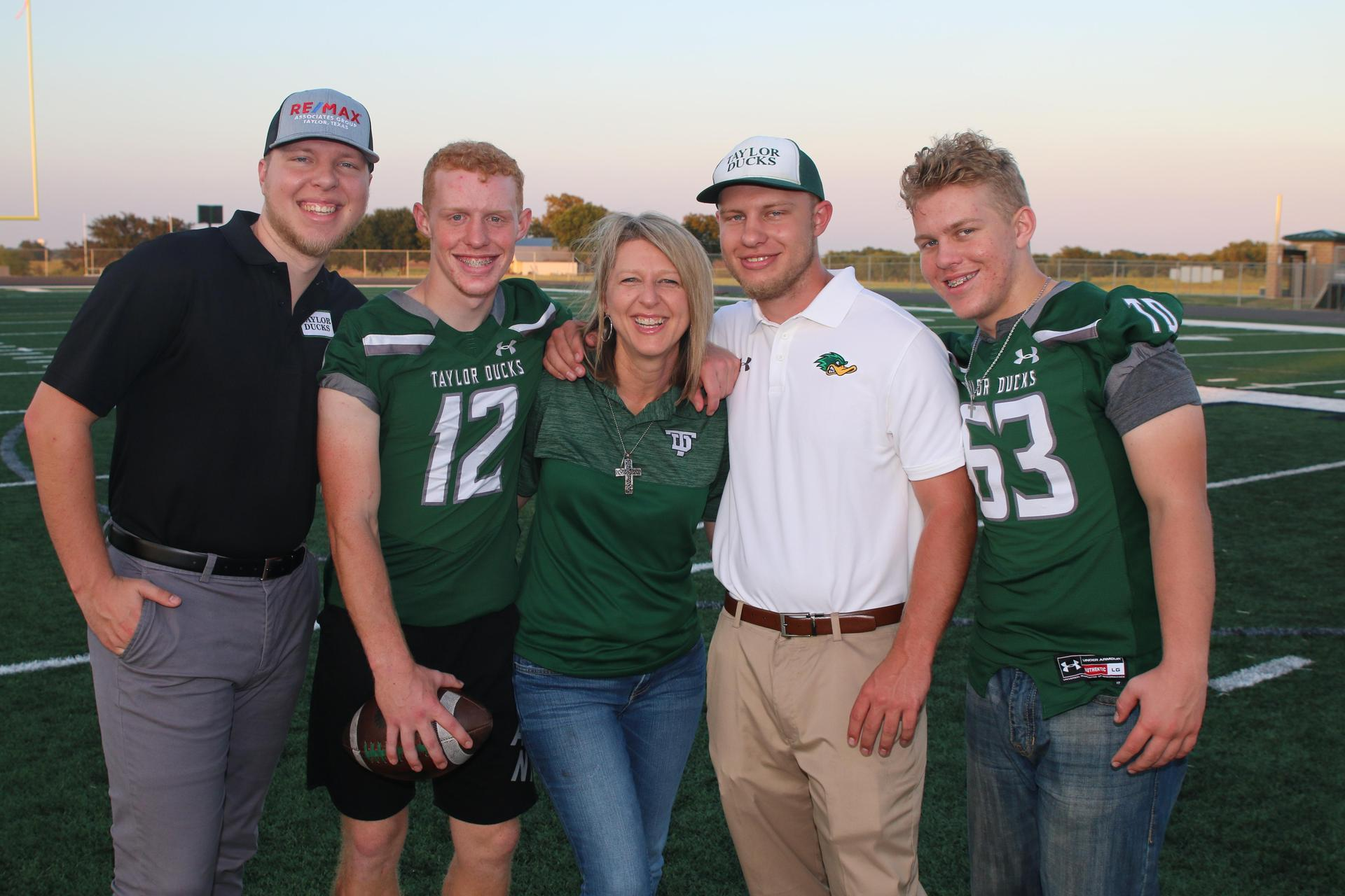 Mrs. Schneider with her four sons.