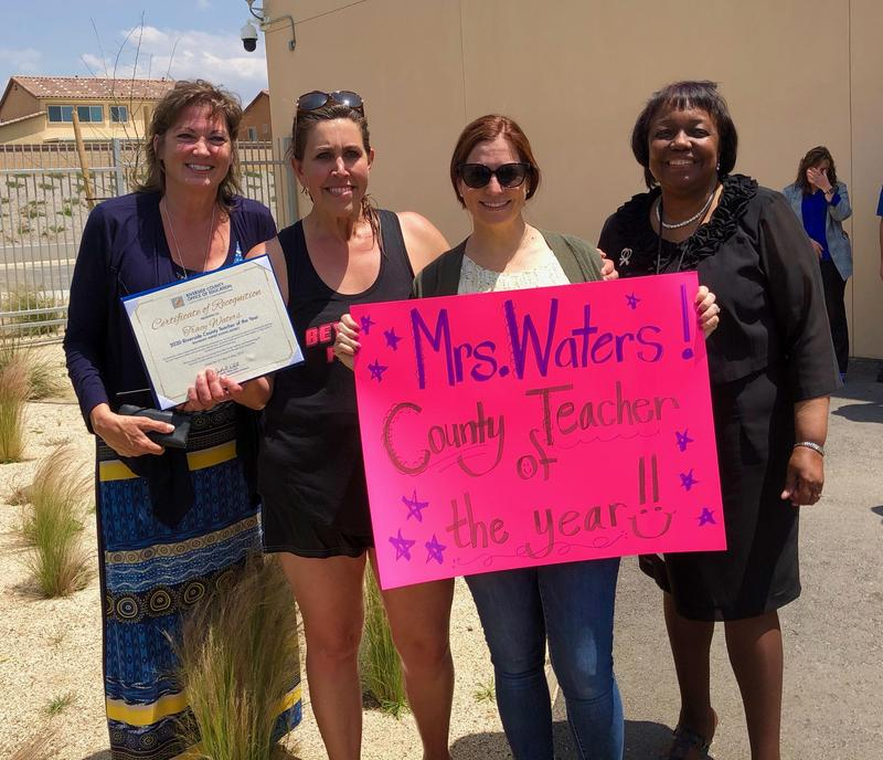 Tracy Waters, Lauren Kinney, Dr, Judy White, and Starlight Staff holding congratulatory sign