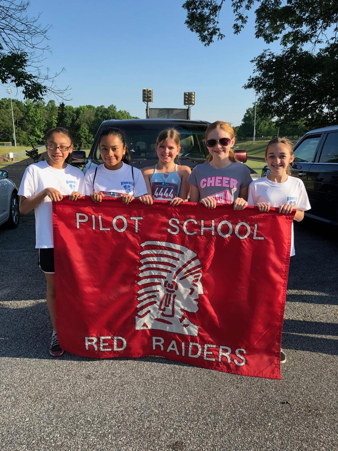 5 members of Pilot Run Club hold