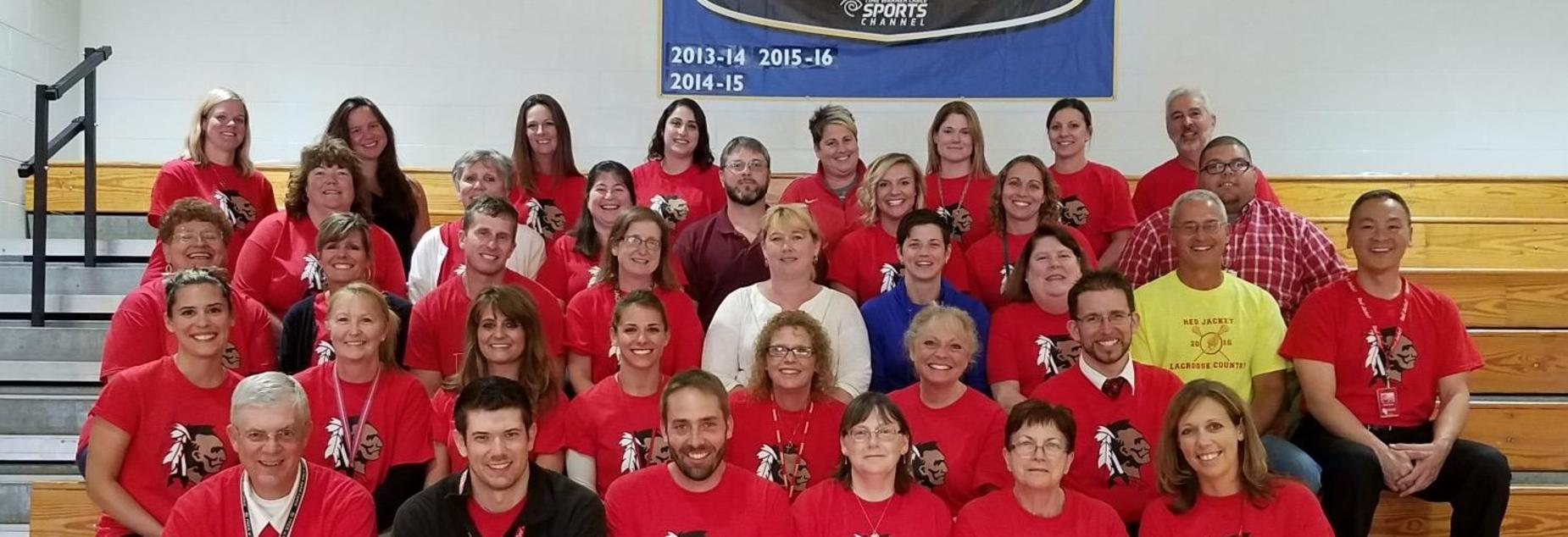 HS staff sitting on bleachers 2017-2018