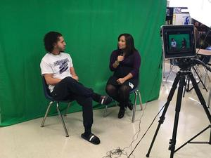 Reporter interviewing student