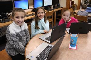 Washington School students enjoy coding activities during Computer Science Education Week.