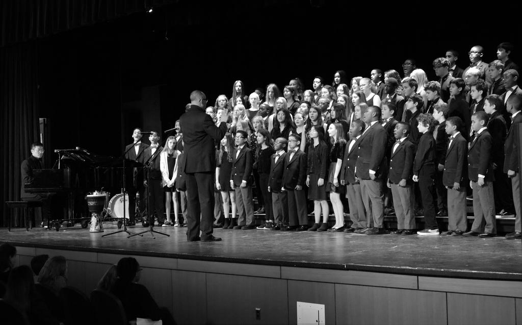 Photo of Newark Boys Choir performing at Roosevelt Black History Month assembly with school's Sharps and Flats singers.