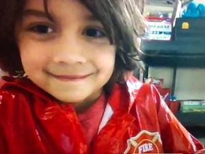 Boy wearing firefighter jacket