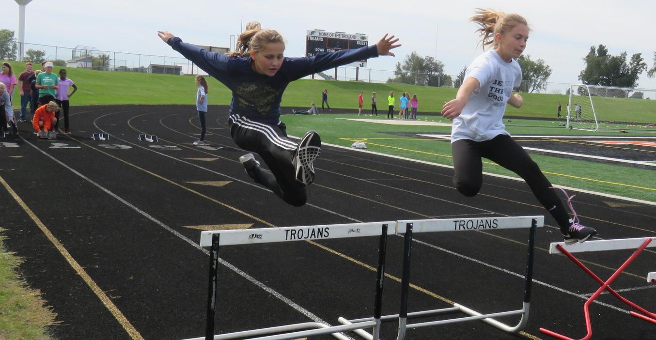 TKMS students try out hurdles as part of Fitness Palooza events.
