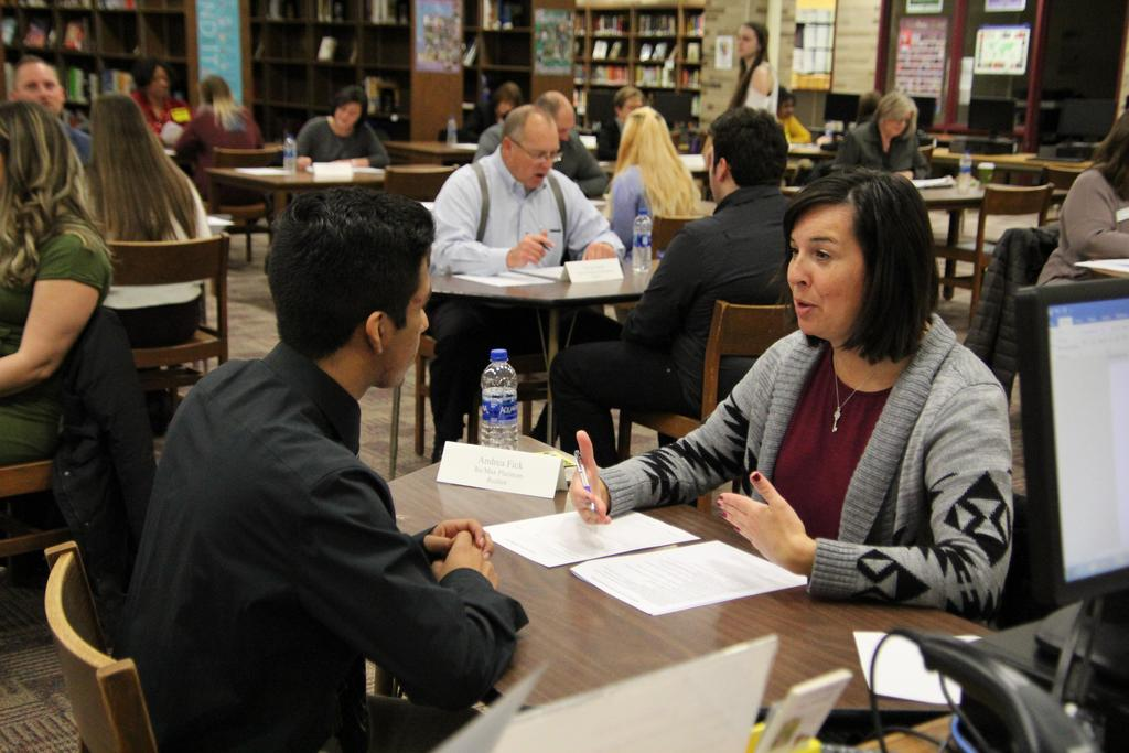 Woman interviewing a student for a job