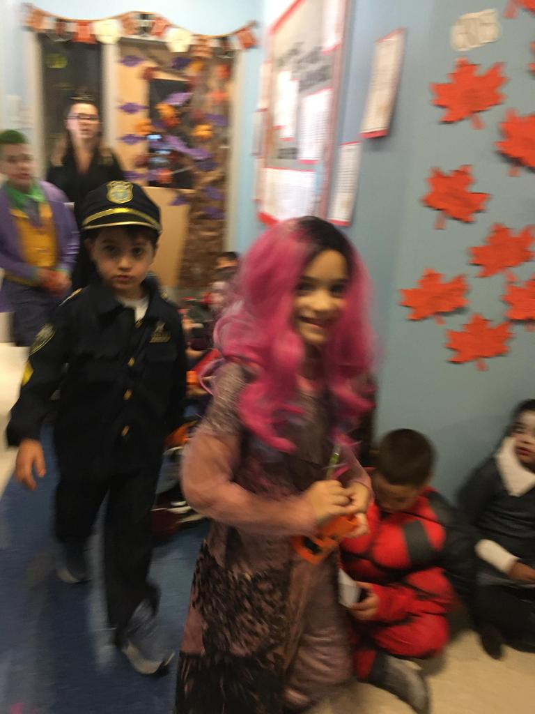 two kids parading in the hallway