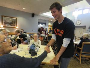 Turner Halle greets a resident at Carveth Village with a smile and a handshake.
