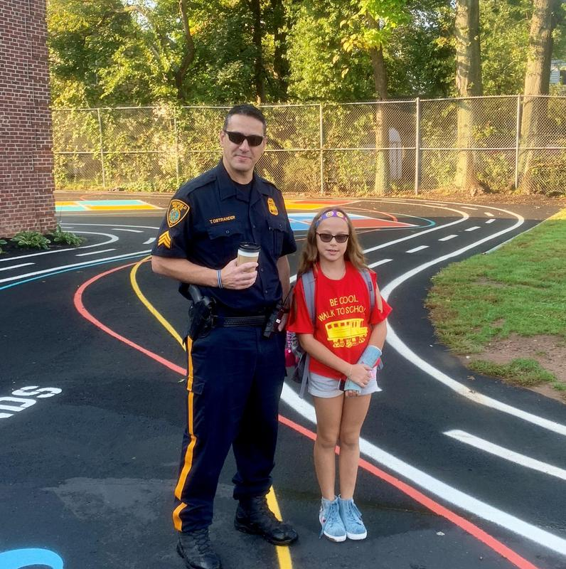 McKinley student receives special escort from Westfield police officer on Walk to School Day.