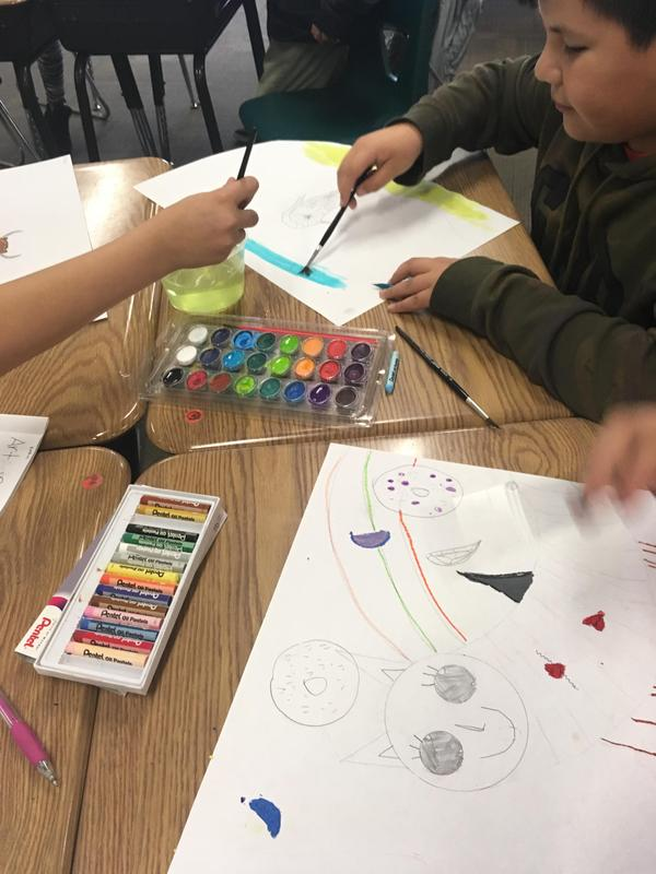Students working on their art at their desks, image 3
