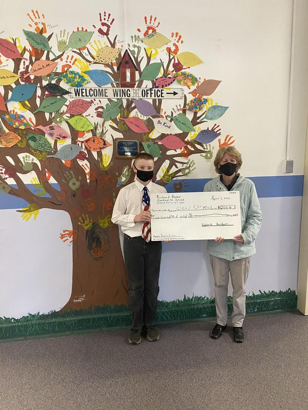 Student standing with principal