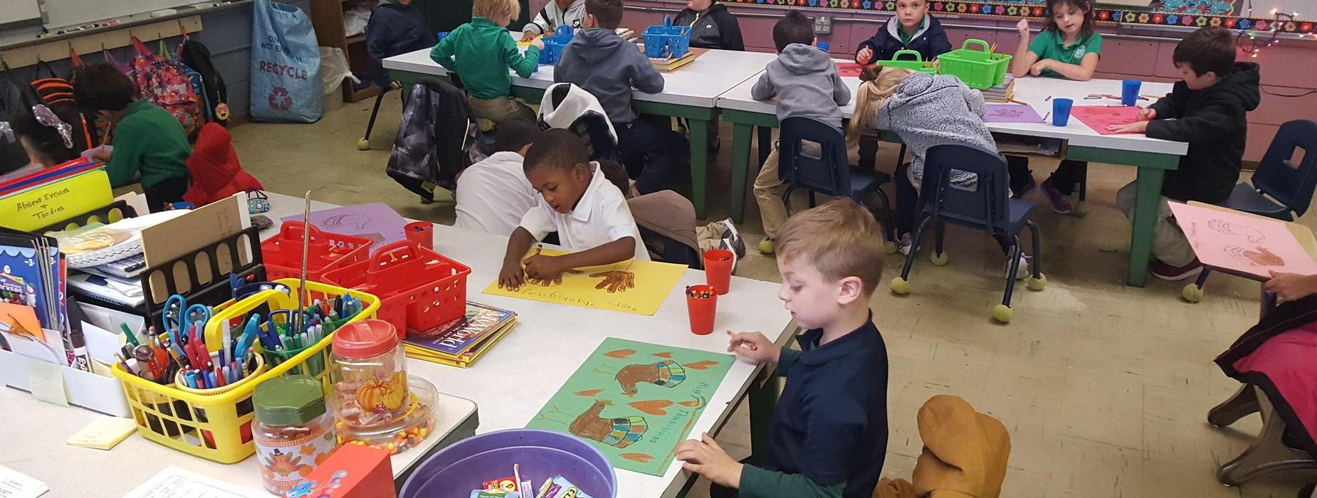 1st grade making placemats for Thanksgiving