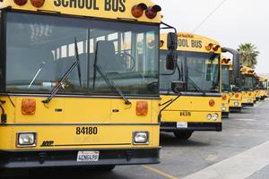 school-busses-parked-in-parking-lot_1906667.jpg