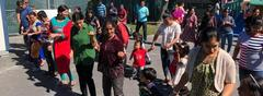 Parents dance with children during international day celebration