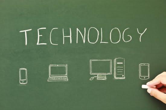 The word technology written on a chalkboard