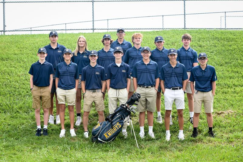 pic of golf team with a golf bag
