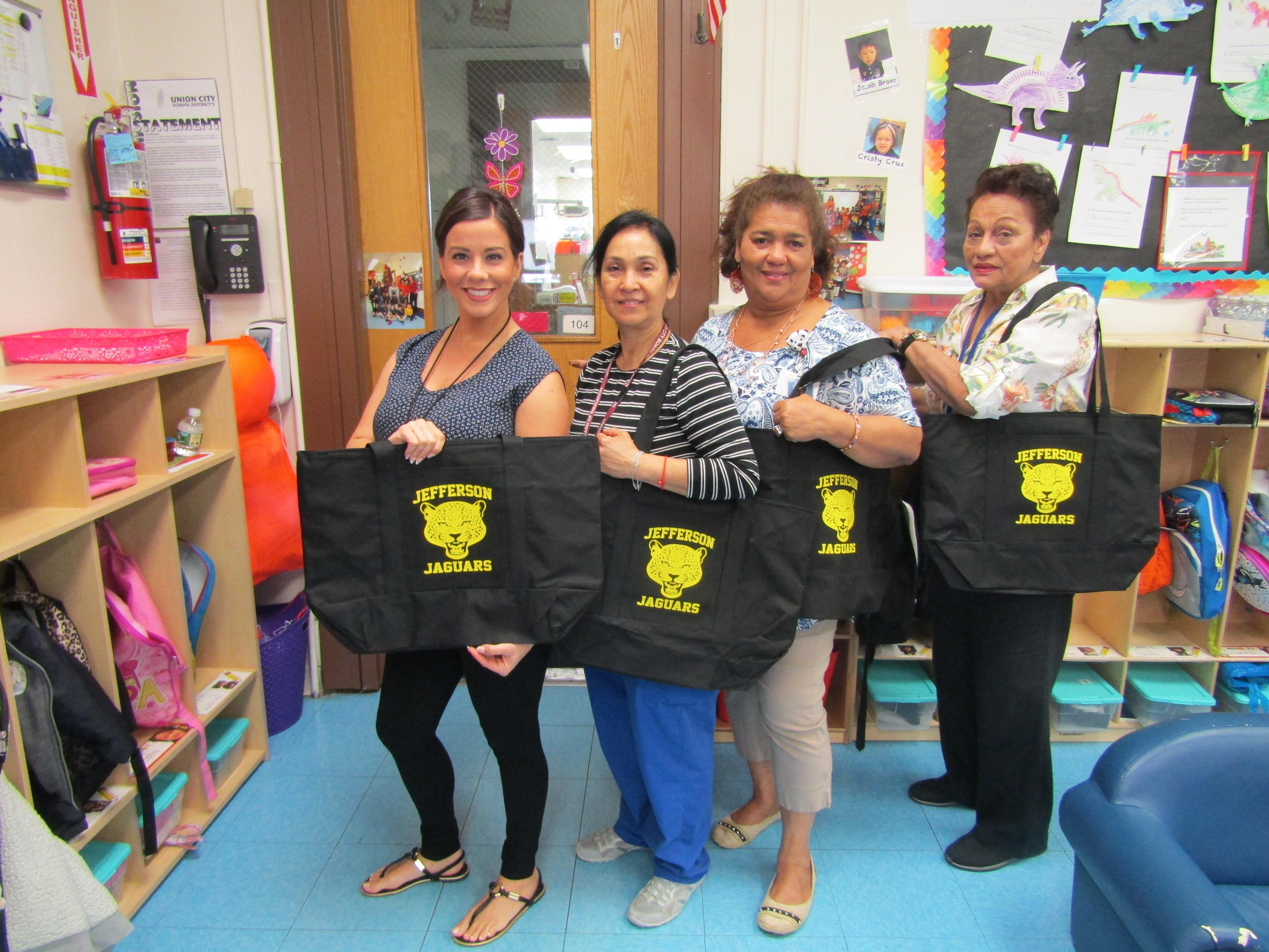 group 2 of teachers holding their bags