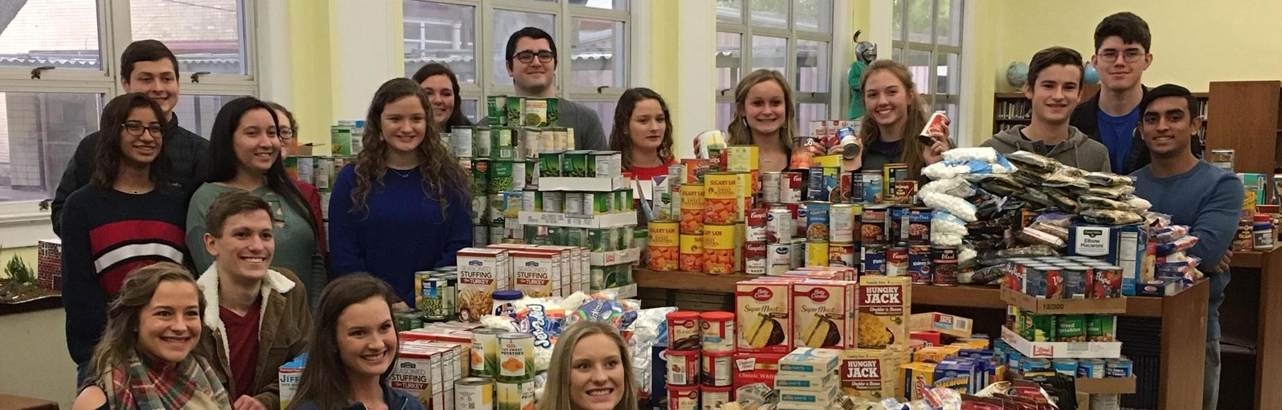High School Students with food for food drive