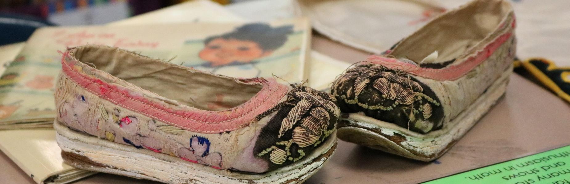 Photo of Chinese child shoes, part of a group of Chinese artifacts on hand for Franklin 2nd graders