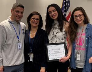 Alexandra Jackman (3rd from left) is welcomed to Roosevelt Intermediate School by (L-R) principal Brian Gechtman and teachers Karen Lust and Andrea Poppiti.