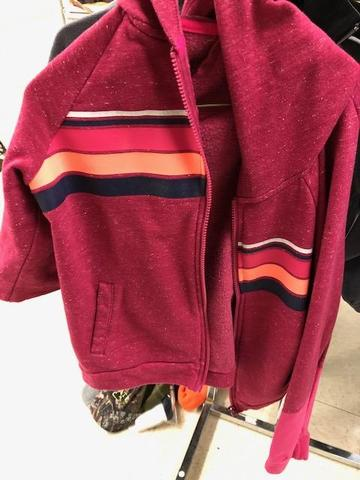 pink jacket with orange and navy stripe