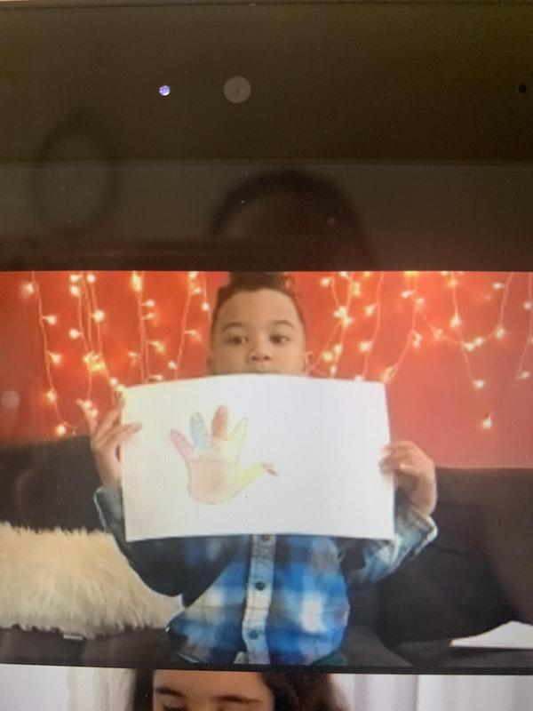Student holding turkey drawing on zoom