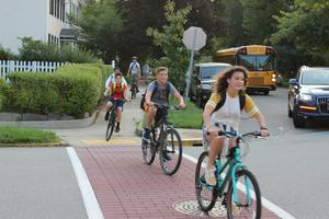 Students biking to school on the 1st day.