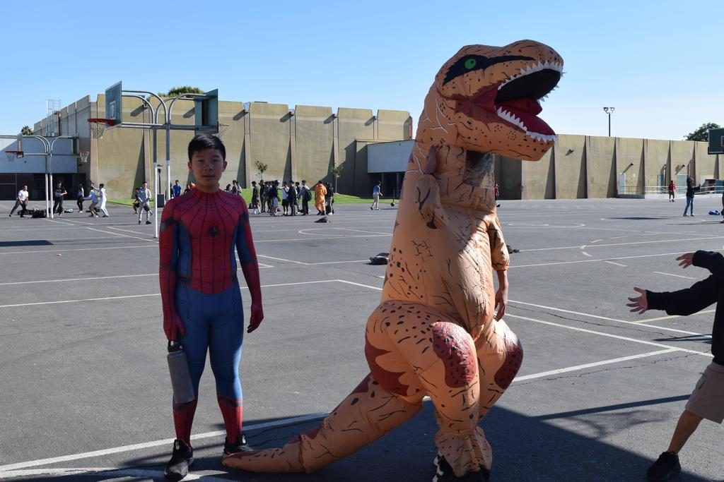 One student dressed up as Spiderman, and another student dressed up in an inflatable dinosaur costume.