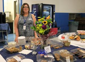 Photo of WHS educator with welcome banquet for new principal and staffers.