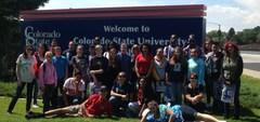 Group of students in front of the University of Colorado Pueblo sign on a field trip