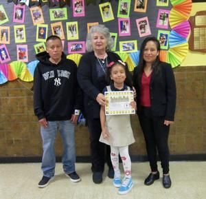 student of the month melissa r with her parents and principal