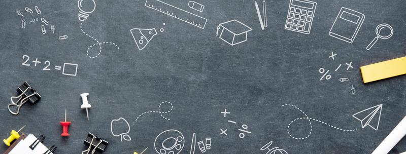 Design concept with doodles, pushpins and paperclips against a chalkboard background