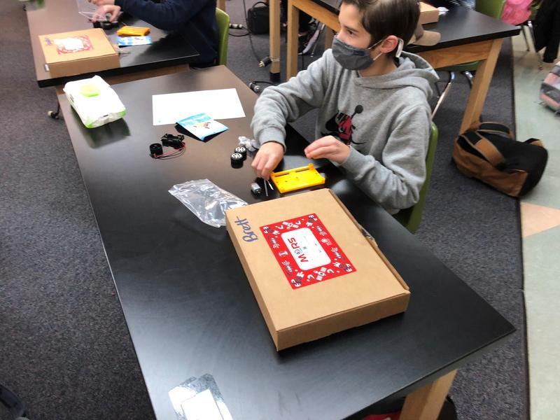 6th Grader at Avery Middle school building mars rover