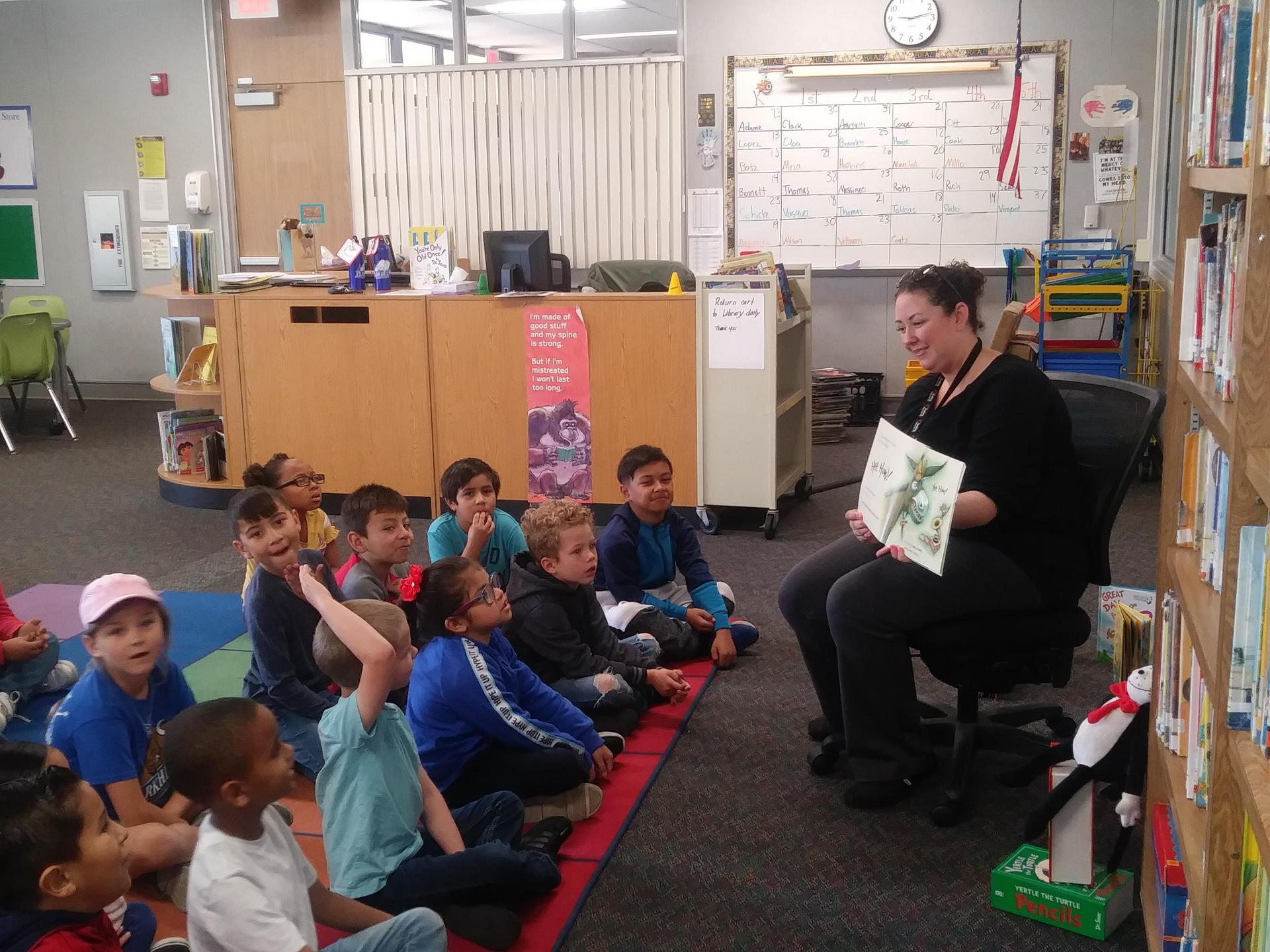 Accounting Supervisor Ashlynn Woods reads to Park Hill Elementary students during Read Across America 2020