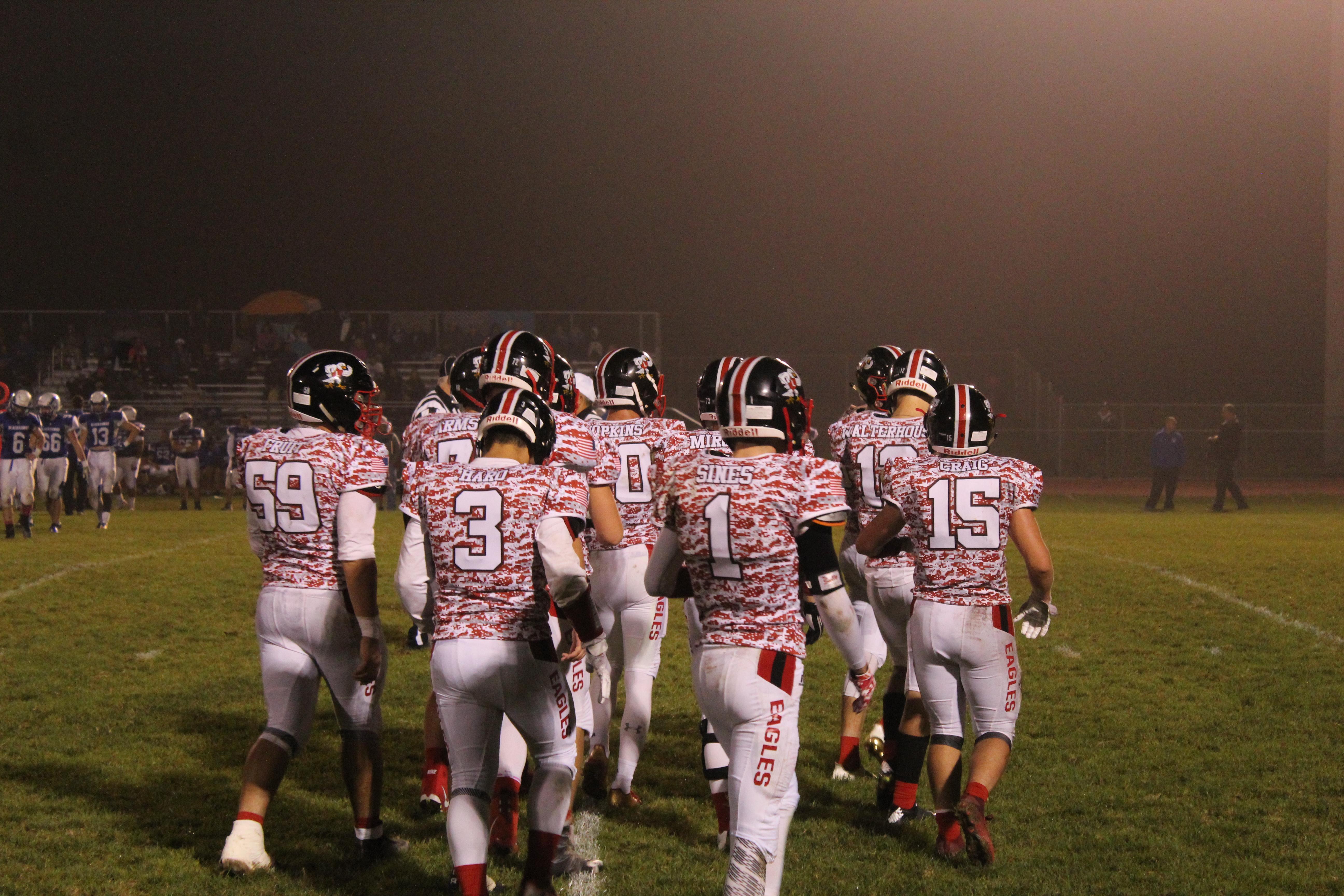 Football team walking onto a football field