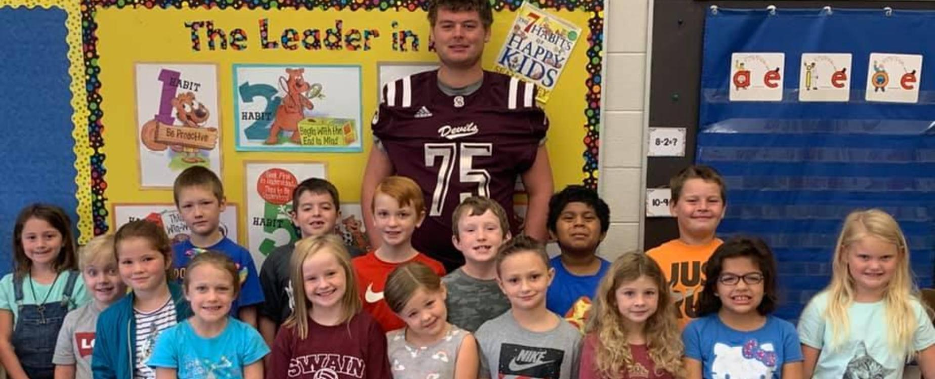Hmmmm, one of these is not like the others, Nick Millsaps (#75) went to read to West students during Homecoming