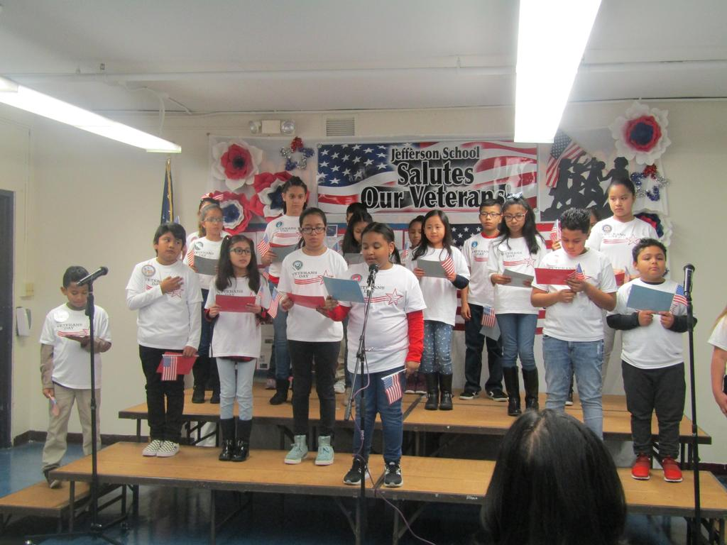 girl reading veterans poem at assembly
